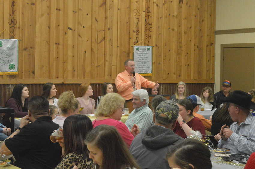 Madison County Extension Agent Chadd Caperton addresses 4-H families during the organization's 66th annual banquet last Monday at the Fairgrounds.