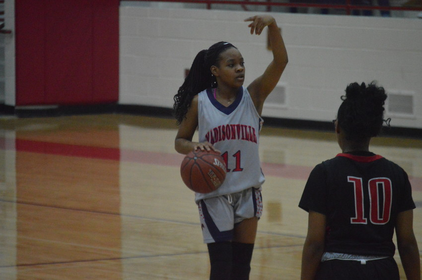 Madisonville's Daiona Johnson directs the Lady Mustangs offense during Friday night's loss to Rusk at MHS.