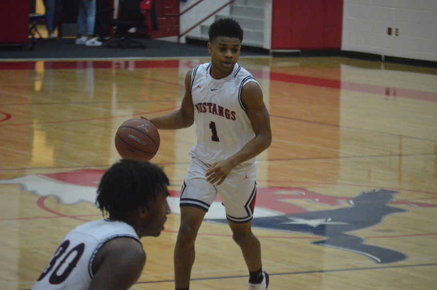 Madisonville's Tyrese Brown, who led the team in scoring against Fairfield with 18, looks to set up a play at MHS on Friday.