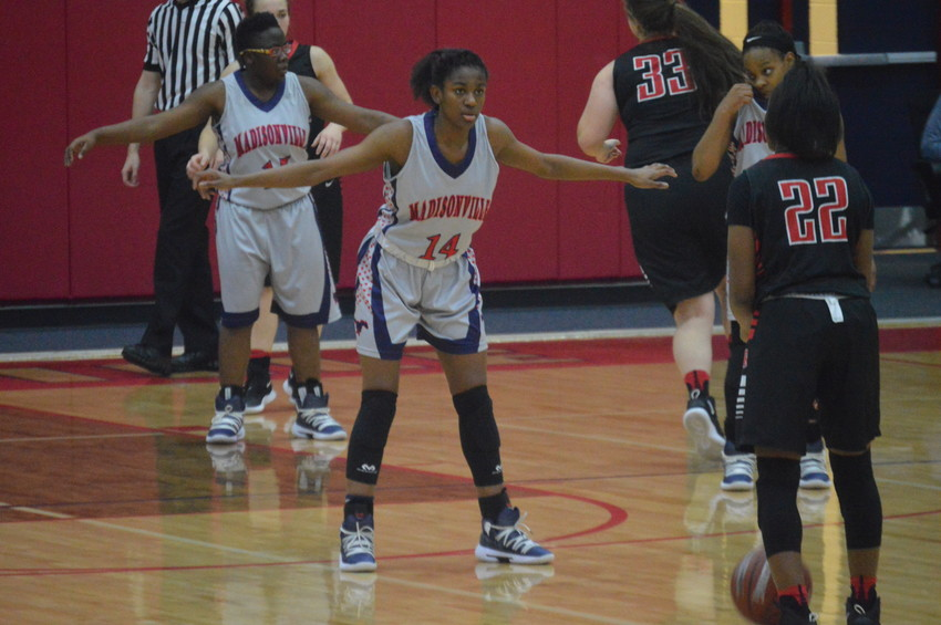 Madisonville's Khyra Cooper defends her basket during a Madisonville home game.