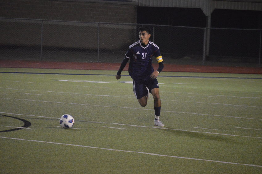 Madisonville's Mauricio Aceves looks to advance the ball during a Mustangs home game at MHS.