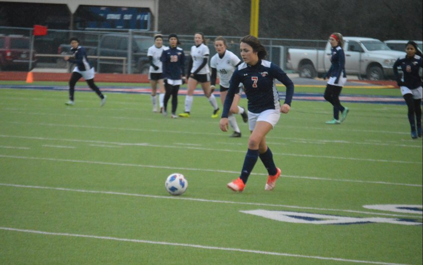 Samantha Vazquez of the Lady Mustangs soccer team advances the ball during a 1-0 Madisonville loss to Huffman-Hargrave on Friday at MHS.