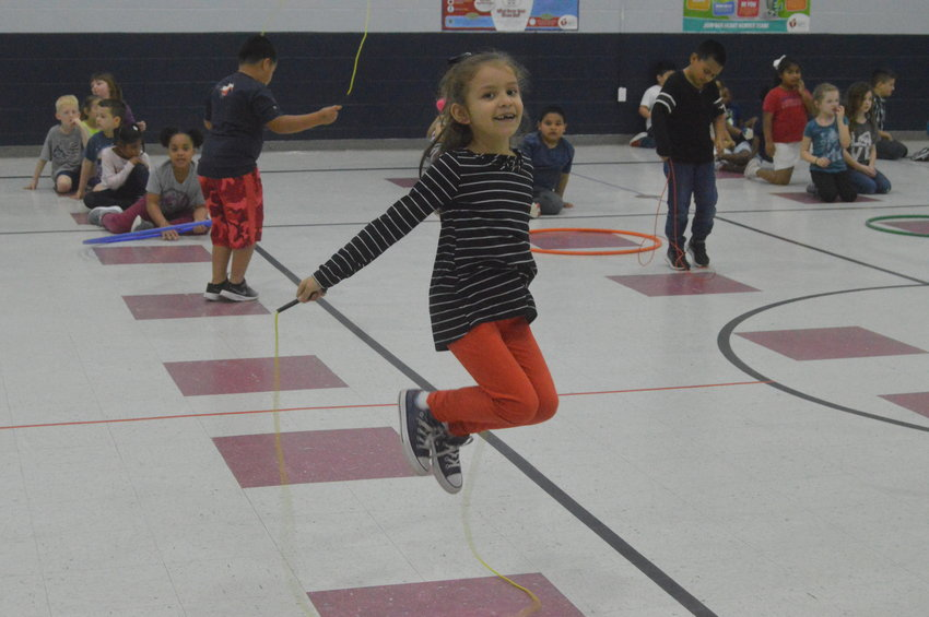 Madisonville Elementary First Grader Jade Orozco participates in the school's annual Jump-athon for the Kids Heart Challenge through the American Heart Association on Friday.