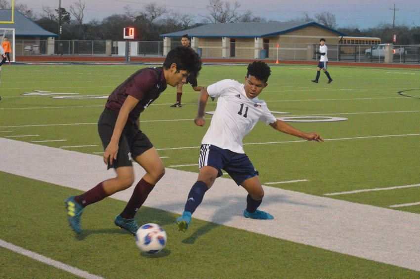 Madisonville's Dixon Veliz makes an attempt at the ball while playing defense during a Mustangs home game.