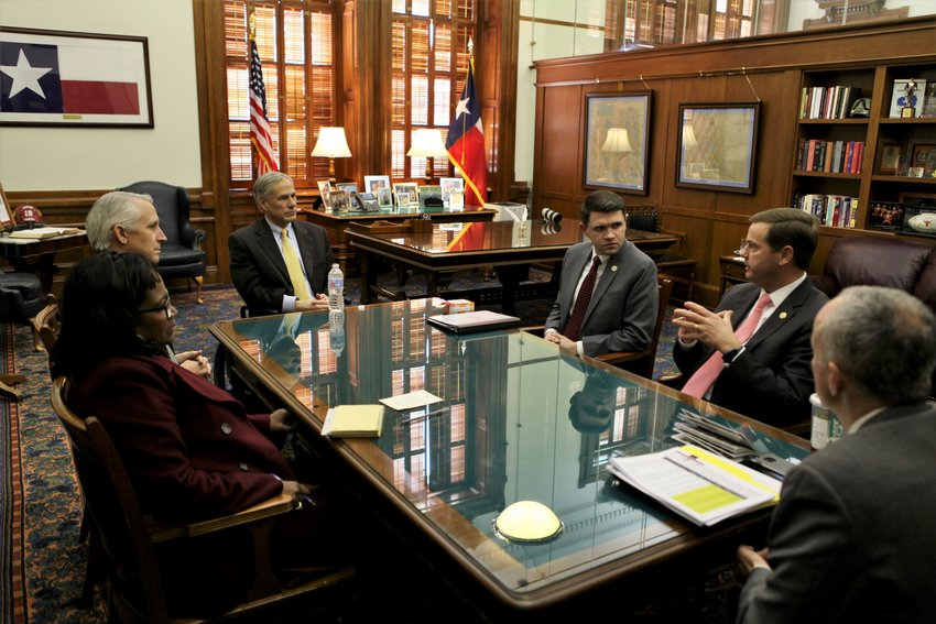 Rep. Trent Ashby, R-Lufkin, meets with Gov. Greg Abbott and other officials regarding school finances.