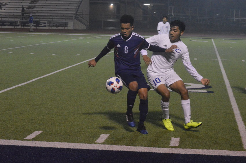 Madisonville's Bayron Veliz battles a Crockett defender for the ball during Friday's 7-3 district win at MHS.