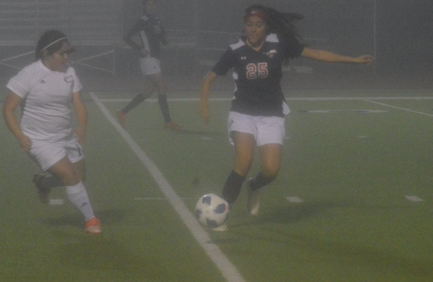 Madisonville's Andrea Hinojosa handles the ball during the team's 6-2 district victory over Crockett on Friday at MHS.