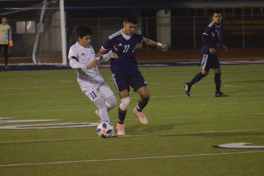 Madisonville's Mauricio Aceves fights a defender for the ball during a Mustangs home game at MHS.