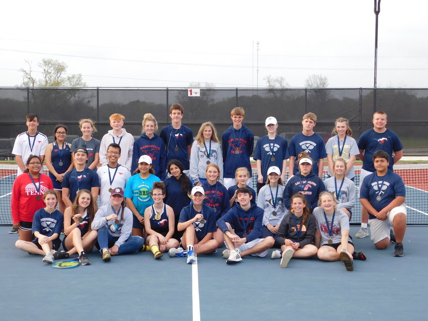 Members of the Madisonville varsity tennis team pose together following a tournament at MHS on March 12.