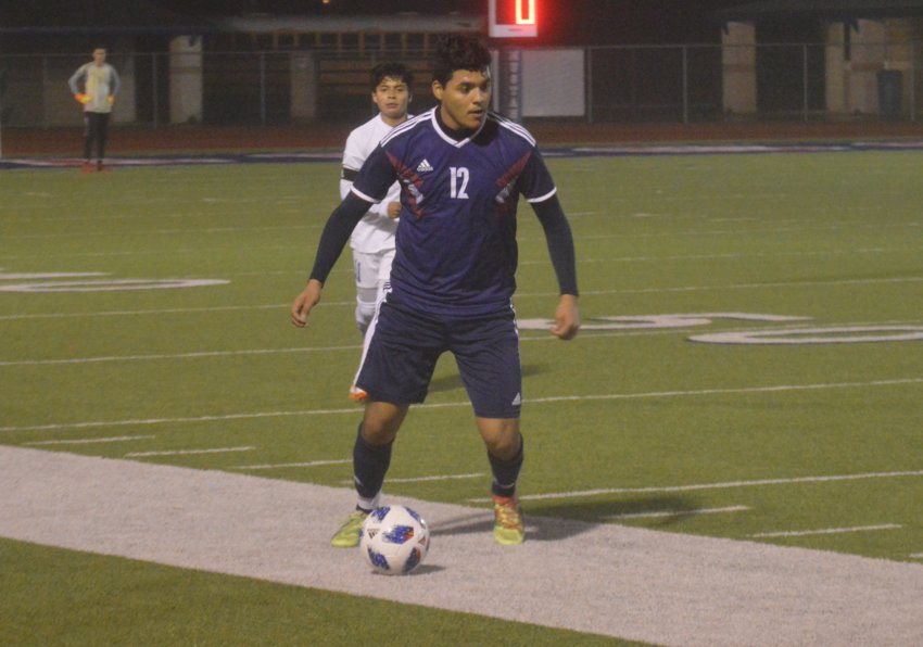 Madisonville's Kevin Flores handles the ball during a Mustangs home game at MHS.