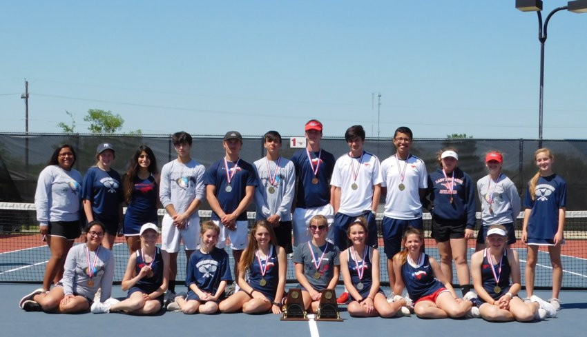 The Madisonville junior varsity tennis team poses together at MHS last Tuesday after winning their district tournament.