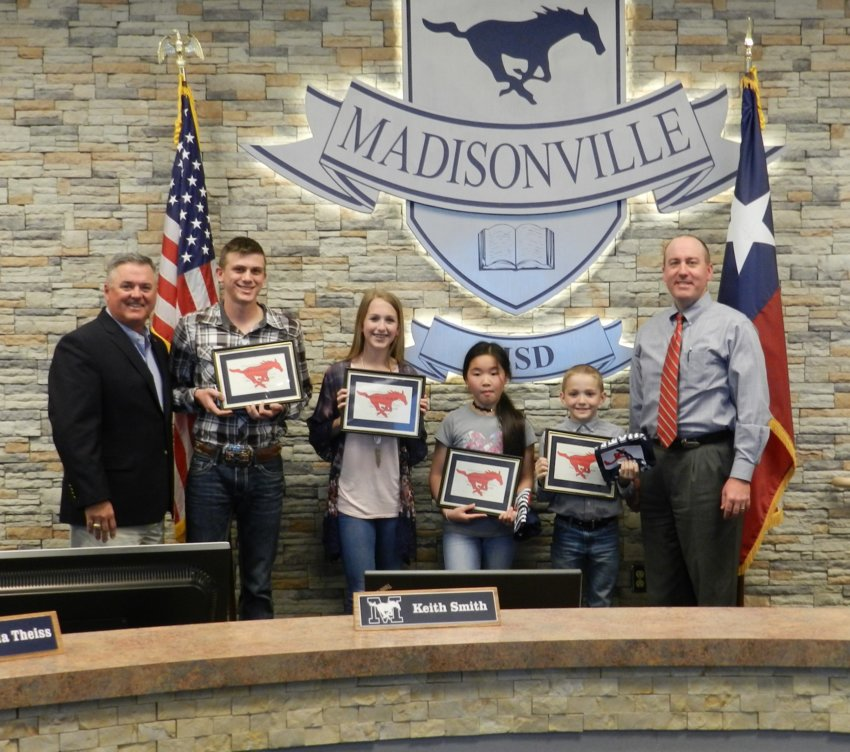 Madisonville CISD Students of the Month (from left) Gabe Coleman, Brynlee Urbantke, Jennifer Jiang and Clayton Grubbs pose with Superintendent Keith Smith (left) and board member Dale Hurst.