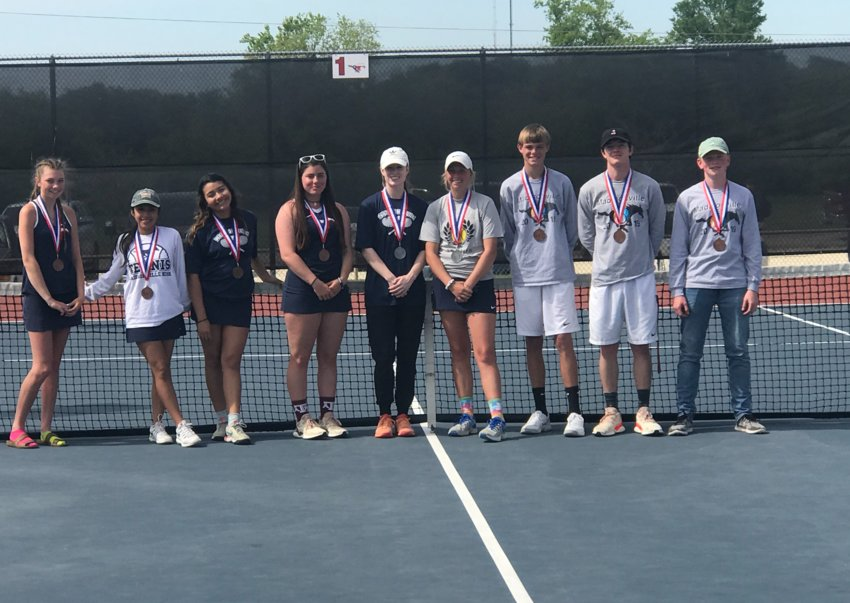 Members of the Madisonville varsity tennis team pose together following their district tournament at MHS last week.