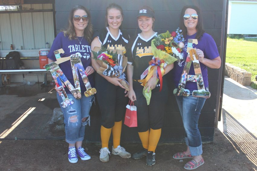 North Zulch senior softball players Ally Grier (left) and Megan Massey pictured with Stephanie Massey and Lindsey Schram on senior night at NZHS.