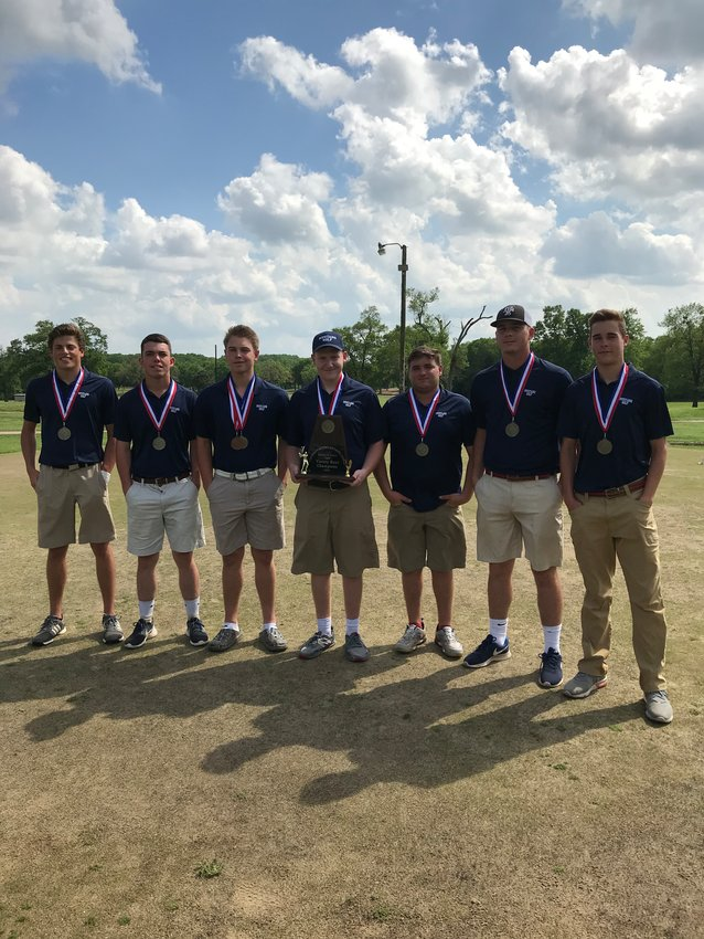 Madisonville golfers (from left) Brylen Mills, Max Allen, Brad Rudis, Cade Colwell, Jordan Prescott, Brandon Larson and Jordan Baker pose together after winning the district championship in Fairfield.