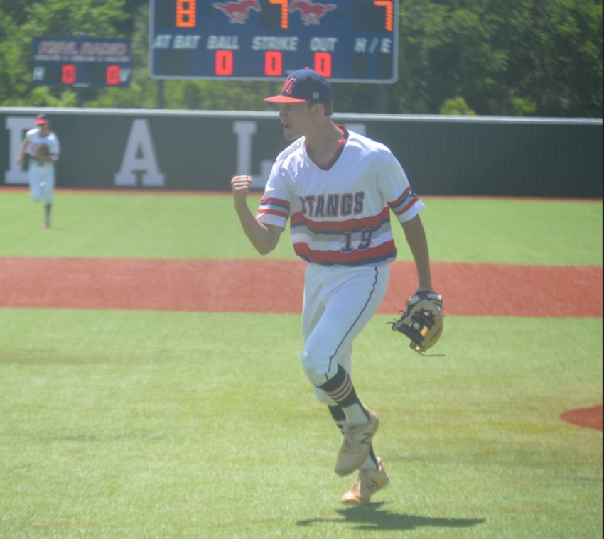 Madisonville's Dylan Stanley pumps his fist after retiring the final out of game two against Jasper on Saturday at MHS. The Mustangs will begin the Area Round against Robinson on Friday in Cameron.