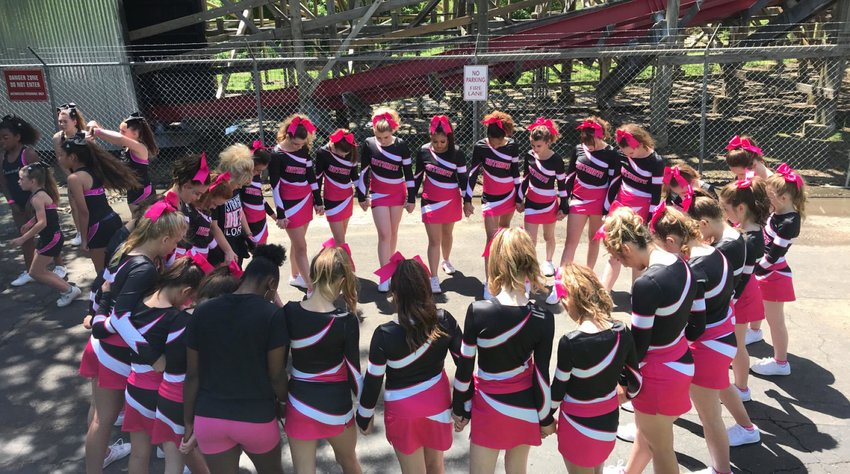 The Hotshots Senior team comes together before competing at Six Flags.