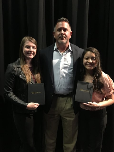 Madisonville High School Valedictorian Alexis Ghormley (left) and Salutatorian Areli Ibarra pose with Principal Heath Brown at the Senior Scholarship and Awards Ceremony at MHS last Tuesday.