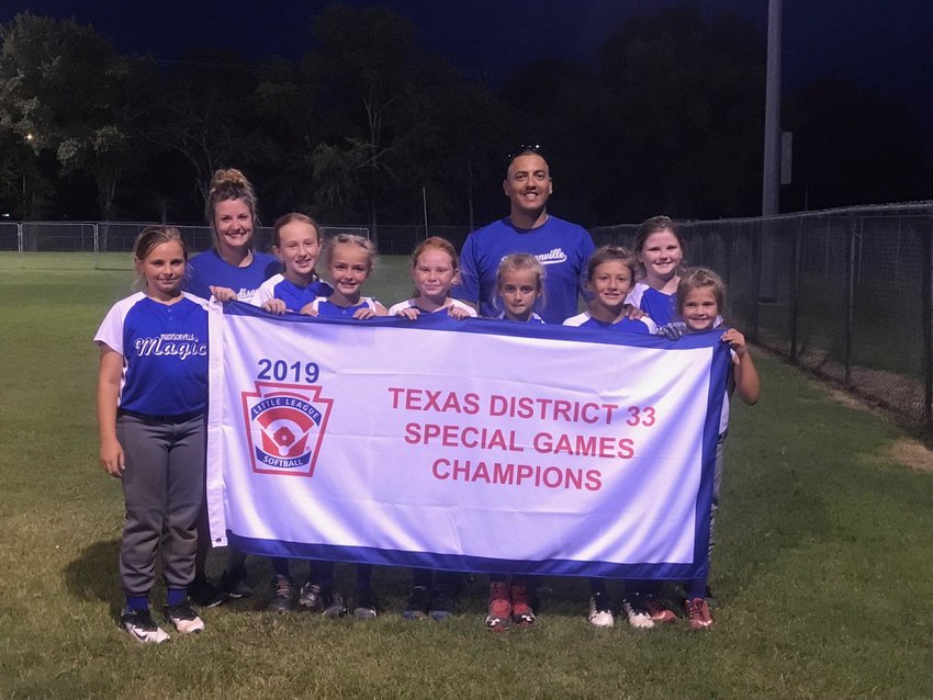 The Madisonville 10U Special Softball Team, the 'Madisonville Magic,' pose together with their district championship banner after winning last week's tournament at Lake Madison Park.