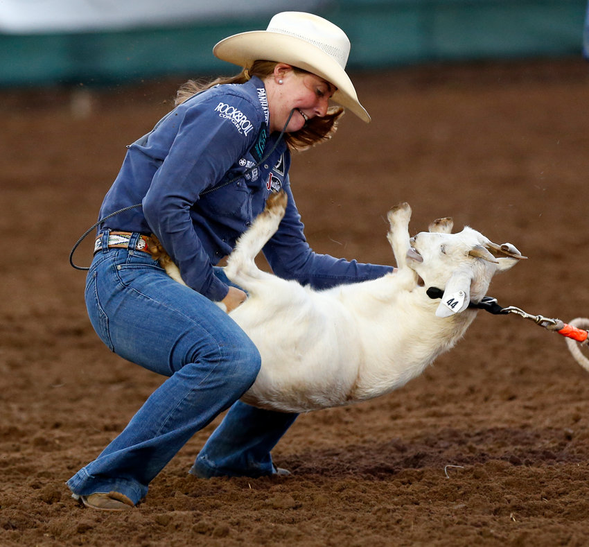 Aly Ghormley of Madisonville, Texas, competes in goat tying during the International Finals Youth Rodeo at the Heart of Oklahoma Exposition Center in Shawnee, Okla., Monday evening, July 8, 2019. [Nate Billings/The Oklahoman]