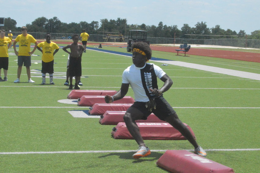 Hope For Youth Football camper Dougkyrn Johnson prepares to receive a pass during a drill on Friday afternoon.