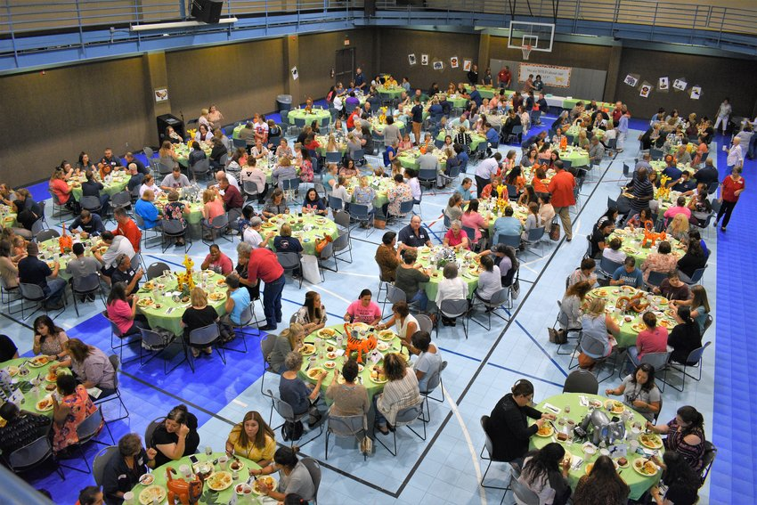 Overhead view of the 11th annual MCISD teacher and staff luncheon in the Family Life Center at the First Baptist Church in Madisonville.
