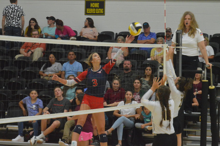 Madisonville's Grace Williamson soars above the net in an attempt to loft the ball over North Zulch defenders on Aug. 20. The Lady Mustangs defeated the Lady Bulldogs in straight sets at NZHS.