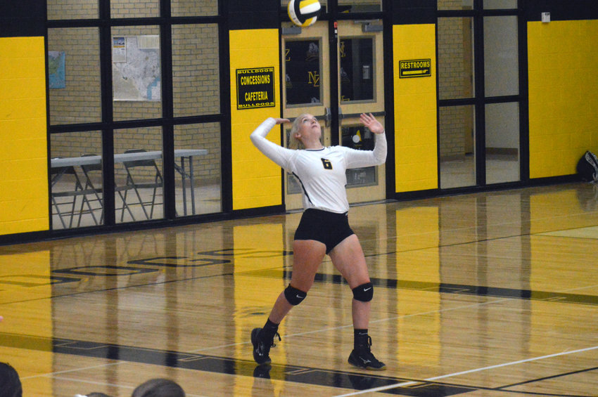 Katie Douga of North Zulch prepares to deliver a serve during a home loss to Madisonville on Aug. 20.