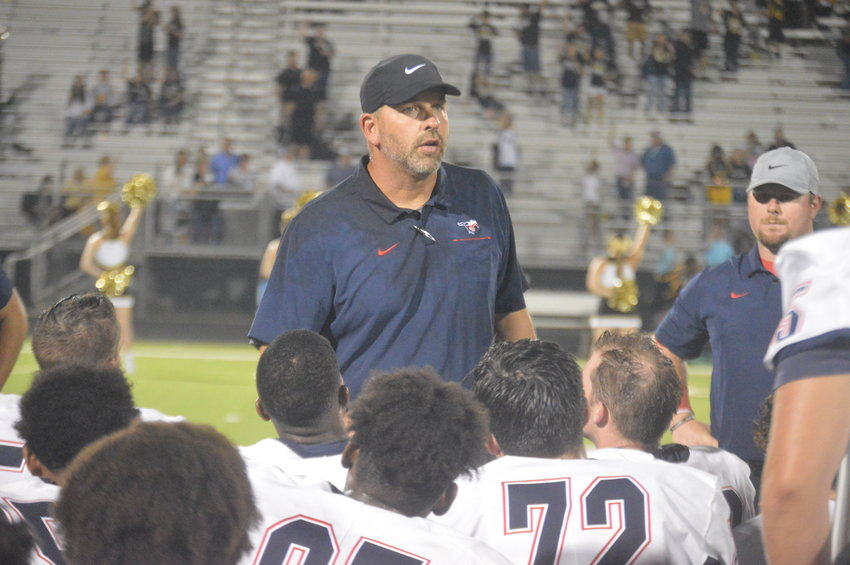 Madisonville head coach Russell Urbantke speaks with the team after Friday's 55-12 win over Woodville. It was the program's first win under Urbantke, who is in his first year at the helm.
