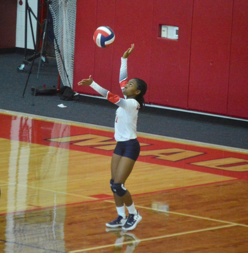 Madisonville's Kia Moffett prepares to deliver a serve at MHS earlier this season.