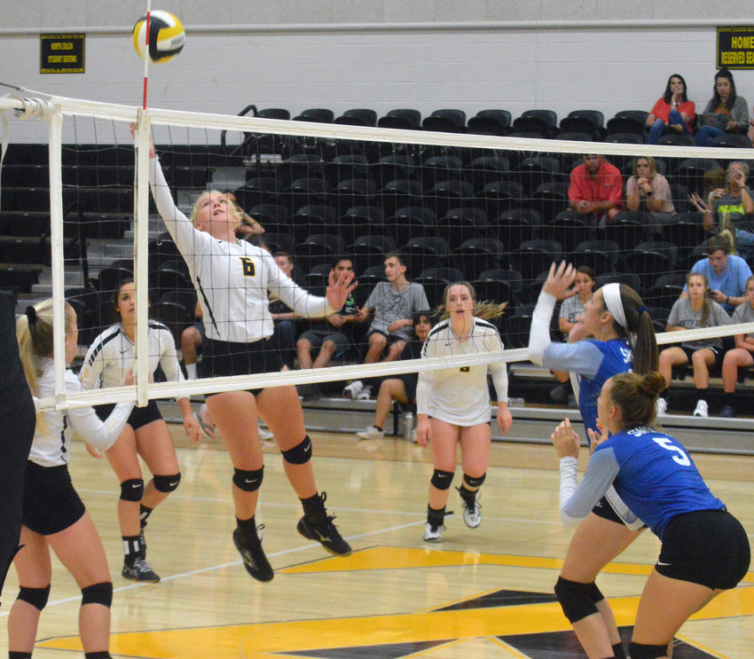 Katie Douga of North Zulch goes up high for a ball during the team's home loss to Snook on Sept. 3.