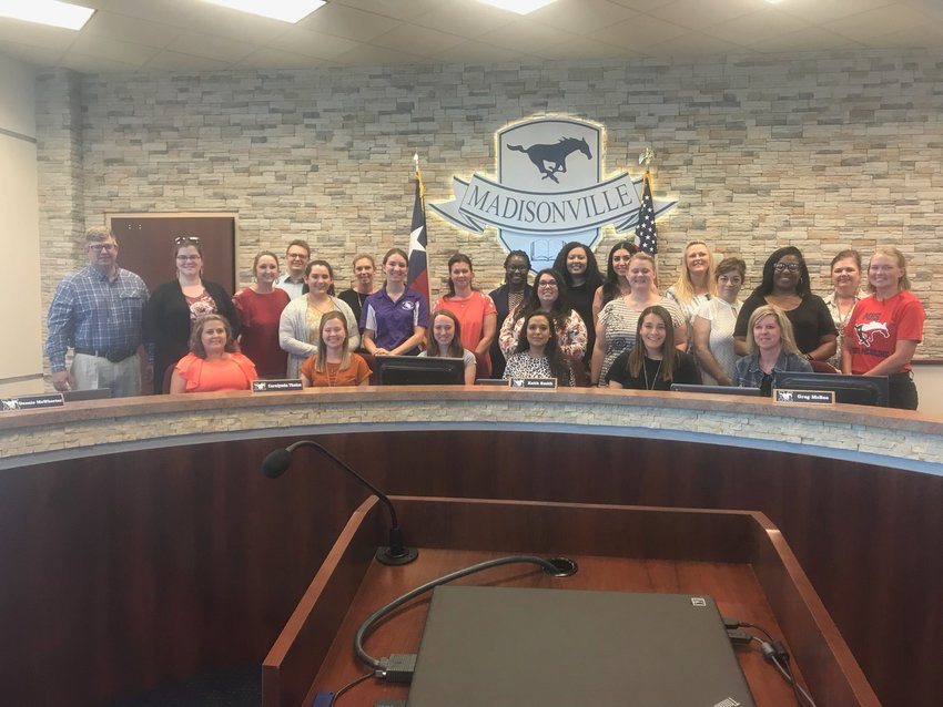 New MCISD educators pose together before Monday's school board meeting for September.