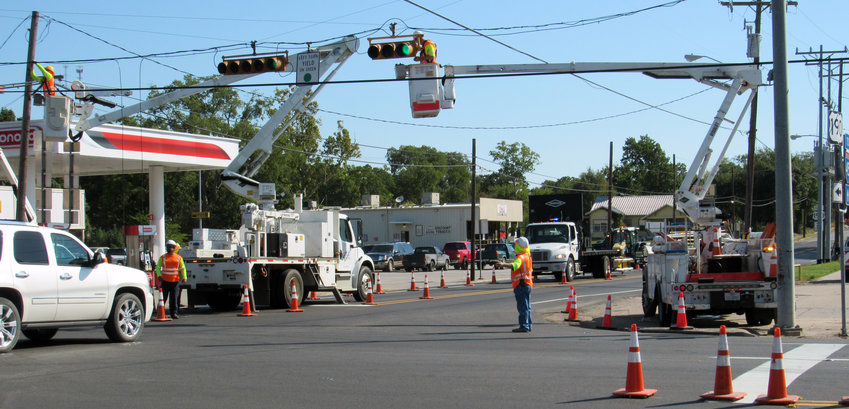 Workers make adjustments Sept. 4 to the traffic signals at the intersection of State Highways 75 and 21. A change in the lane patterns on 75 caused major traffic woes at the intersection until the lights were re-timed.