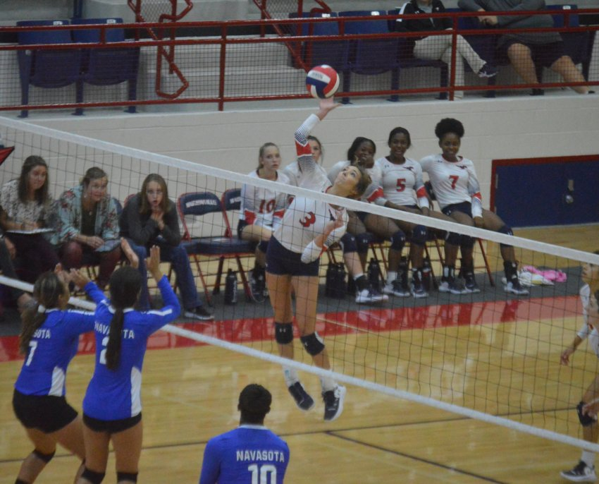 Madisonville's Grace Williamson goes up high for a kill in a home sweep of the Navasota Rattlers on Sept. 10 at MHS.