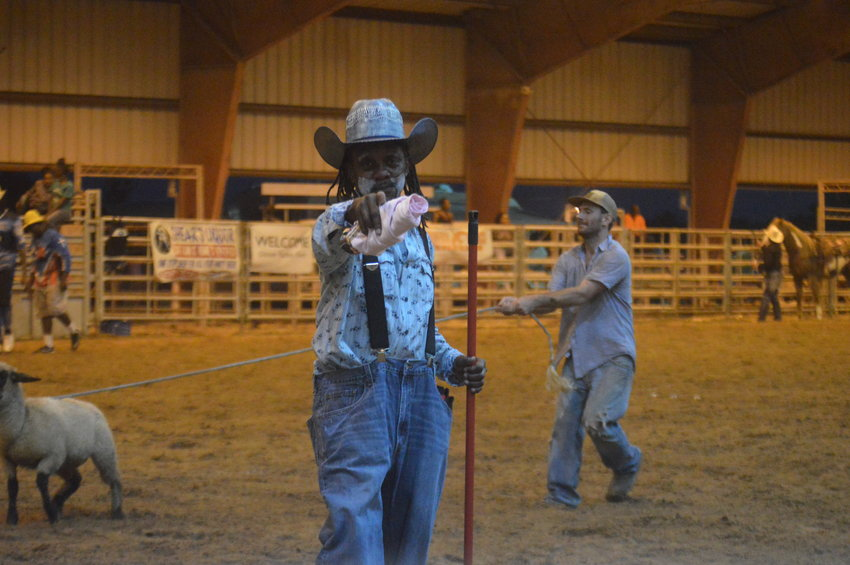 Charles Williams, Glover Rodeo's rodeo clown, searches for enthusiastic spectators to toss a T-shirt to at Robertson County Fairgrounds in Hearne on Saturday. Glover's Rodeo celebrated their 38th annual event over the weekend.