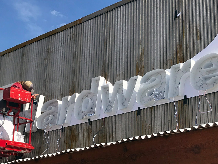 Workers began installation of the ACE Hardware sign on Main St. Thursday.  ACE Hardware will soon fill the former Family Dollar space.