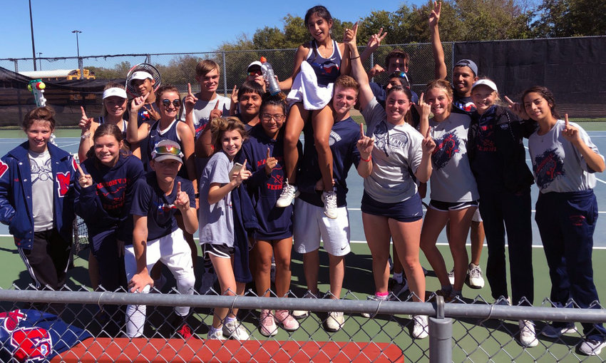 Members of the Madisonville tennis team pose together following a victory in the Area playoff round at Groesbeck High School to advance to the Regionals Quarterfinals against China Springs.