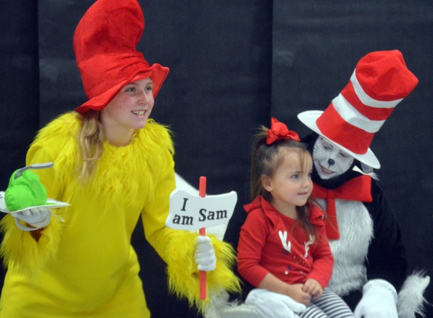 Myka Fontenot has her photo taken with classic Dr. Seuss characters 'The Cat in the Hat' and 'Sam I Am' during the Madisonville Elementary's book fair on Nov. 5.