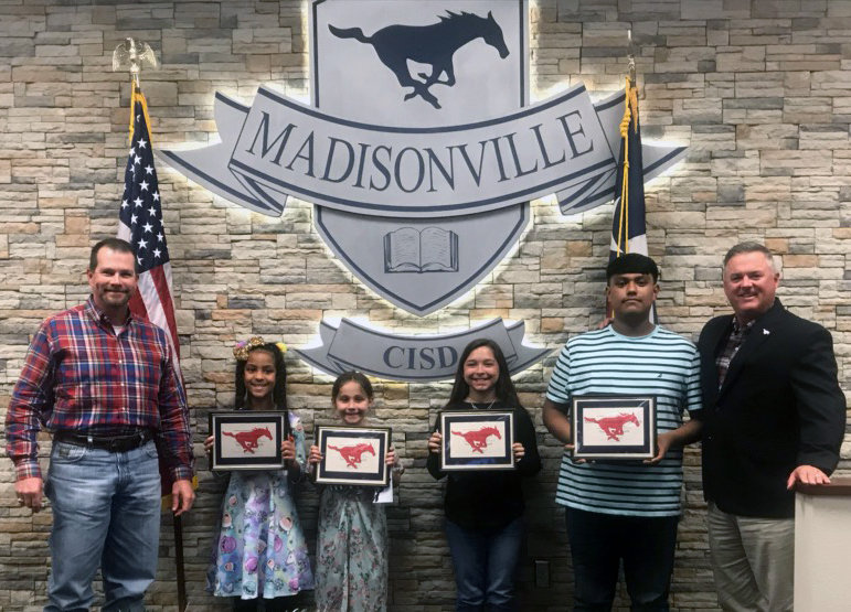 Madisonville CISD Students of the Month (from left) Roselee Seay (Elementary), Rhandii Thornton (Intermediate), Alexis Kennedy (Jr. High) and Manuel Hernandez-Torres (High School) pose with Superintendent Keith Smith (right) and board member Jason Cleere during Monday's meeting.