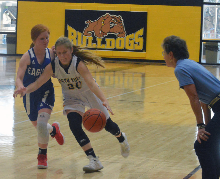Lakin Madden of North Zulch attempts to turn the corner on a defender during a home game at NZHS.