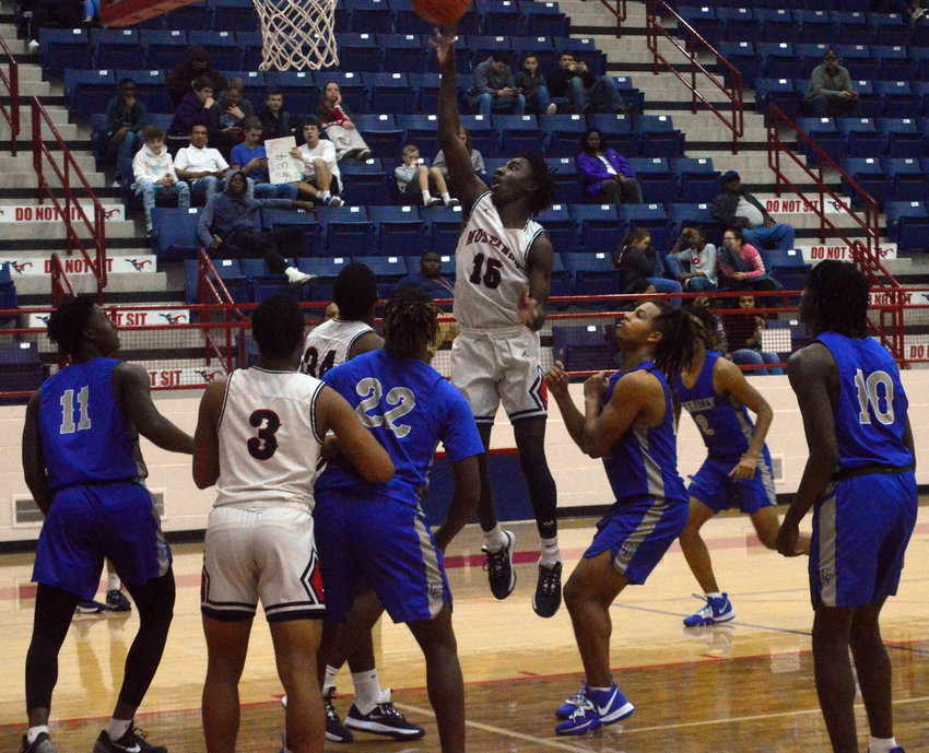 Madisonville's Wayne Roundtree attempts a put-back against the Waco-Connally Cadets during a 64-36 home loss at MHS Friday. The Cadets entered ranked 11th in the 4A Texas Association of Basketball Coaches (TABC) UIL standings.