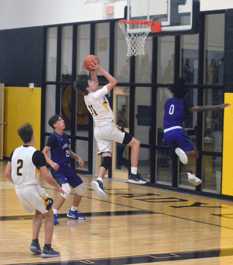 Emory Broussard of North Zulch goes up high to lay in a shot during a Bulldogs home game at NZHS.