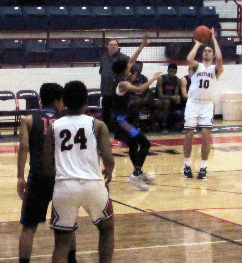 Dylan Stanley, who qualified for the Madisonville Holiday Invitational All-Tournament Team, takes a shot during a Mustangs Friday matchup against Grand Oaks. The team went 2-2 over the weekend with victories over Hempstead and Shepherd and losses to Grand Oaks and La Vega at MHS.