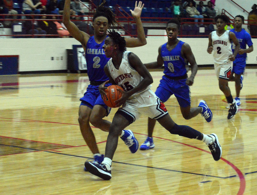 Madisonville's Wayne Roundtree drives to the basket during a Madisonville home game at MHS. The Mustangs dropped a pair of contests to Magnolia and Salado during the week and will now return home for two non-district matchups.