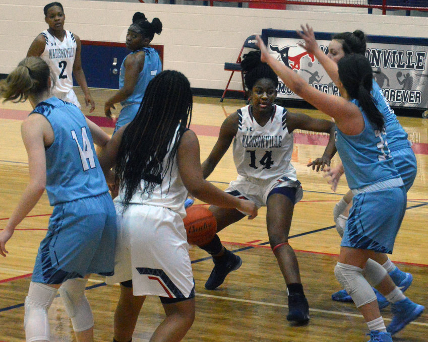 Madisonville's Khyra Cooper works inside against China Spring at MHS Friday.