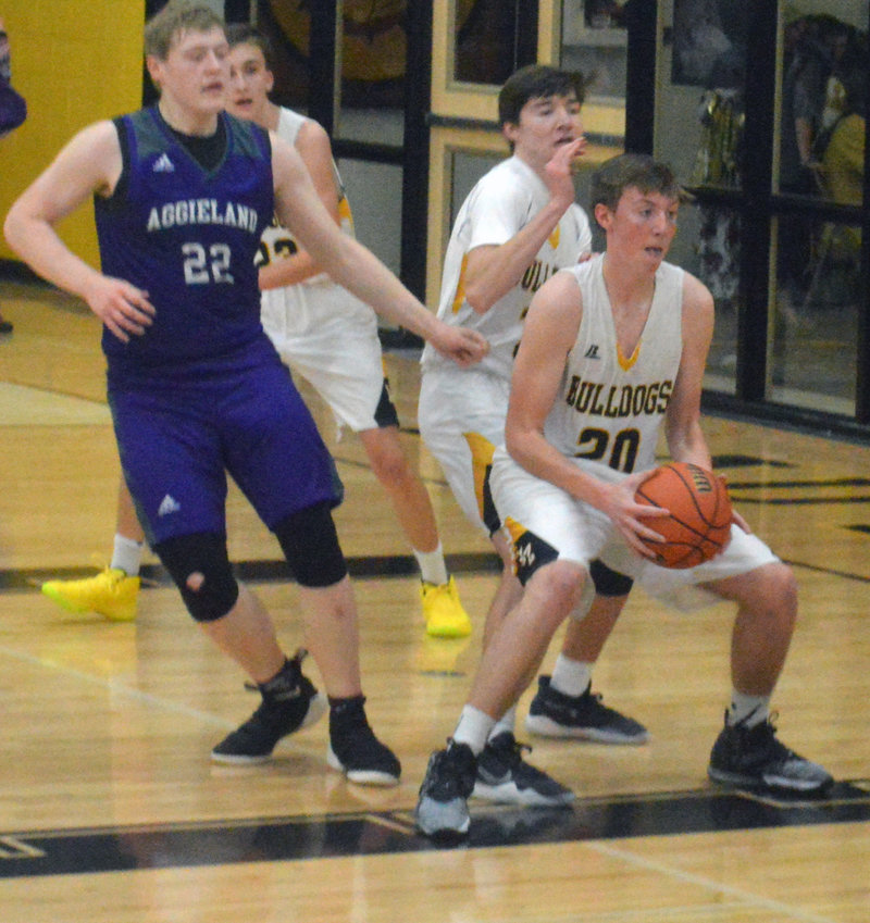 Carson Radde of North Zulch ensures a defensive rebound during a Bulldogs home game at NZHS.