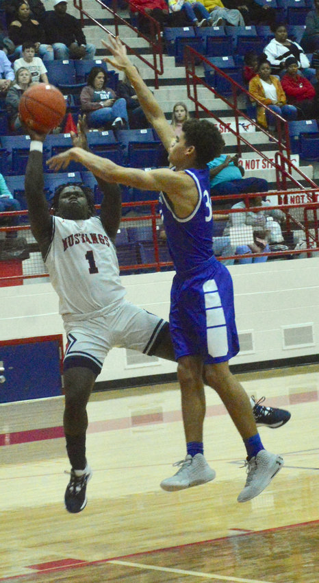 Madisonville's Doug'kyrn Johnson attempts a fade away jump shot during the team's 54-50 loss to Navasota at MHS Friday.