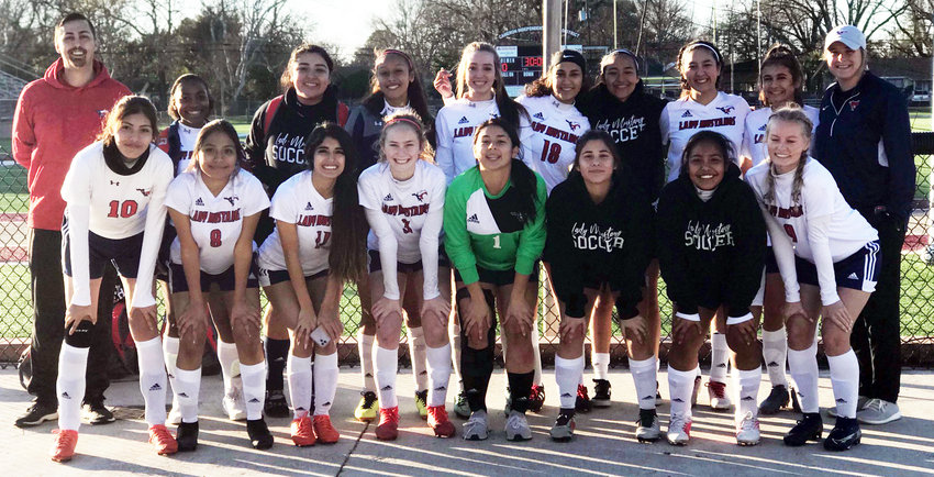 The Madisonville Lady Mustangs soccer team pose together after winning the Silver Bracket at the Yoeman Invitational Saturday in Cameron.