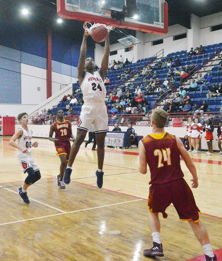 Madisonville graduate Tommy Holiday finishes off a dunk at MHS in 2018.
