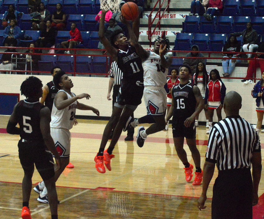 Madisonville's Wayne Roundtree fights his way to the basket for a layup during the team's 81-45 loss to Palestine at MHS Jan. 21. The Mustangs were 1-2 in district play entering Tuesday's road bout in Mexia.